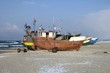 Fishing vessels on beach - 57902223