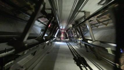Elevator In motion up and down inside elevator shaft