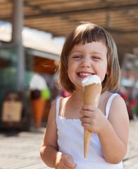 girl eating ice cream at street