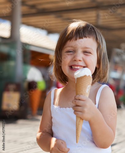 girl eating ice cream at street