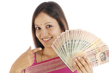 Happy Indian traditional woman with Indian currency