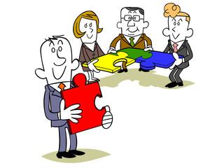 ビジネスマンのチームとパズルのピース