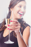 Glamourous woman holding glass of sparkling wine champagne
