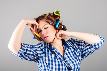 portrait of attractive sexy housewife with curlers