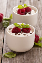 Cream dessert with raspberries
