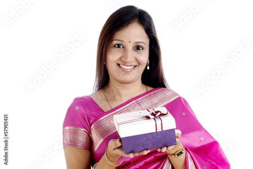 Young traditional indian woman holding a gift box