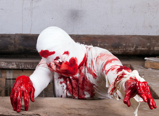bloodied bandages blind zombie attack
