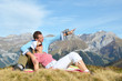 A couple enjoying Alpine panorama. Switzerland