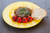 Steak Tartare with toast, butter and tomato