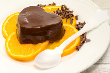 chocolate pudding over orange slices