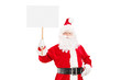 Smiling Santa Claus holding a blank panel