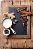 Indian masala chai Ingredients on vintage slate chalk board