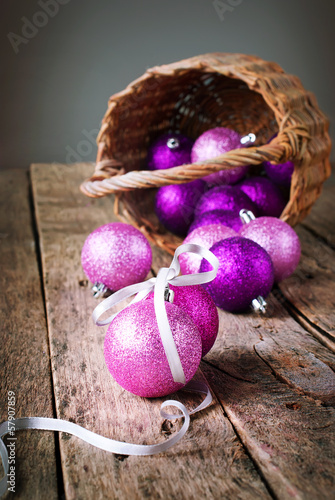 Brilliant Bright Christmas Balls from basket on the Wooden Table