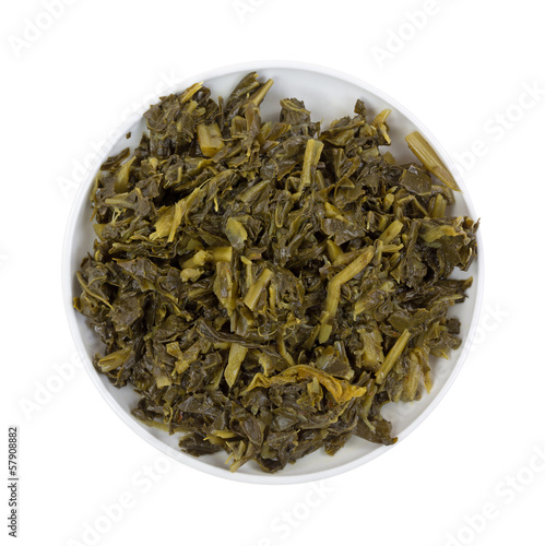 A bowl of collard greens on a white background
