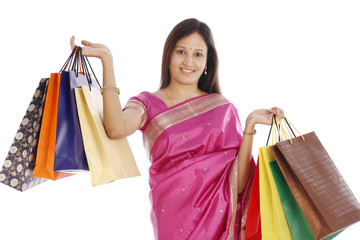 Young Indian traditional woman with shopping bags