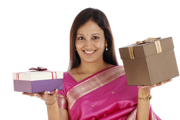 young traditional woman holding gift boxes