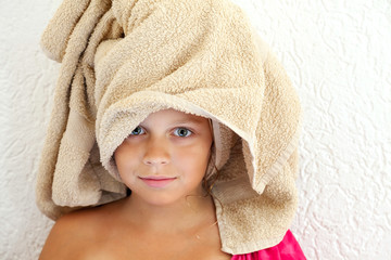 Little girl after bath with towel on her head