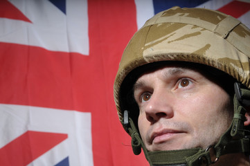 British Soldier With Union Jack Flag