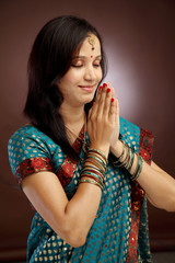 Young indian traditional woman praying