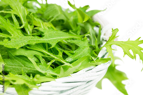 Arugula salad in a wicker basket
