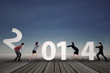 Businesspeople arrange new year 2014