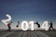 Businesspeople arrange new year 2014