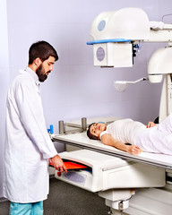 Patient with trauma and doctor in x-ray room.