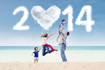 Cheerful family celebrate new year at beach