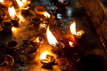 Burning oil lamps at religious temple