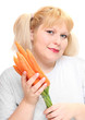 Overweight woman with fresh carrot.