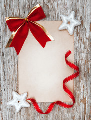 Christmas card with red bow, stars and ribbon