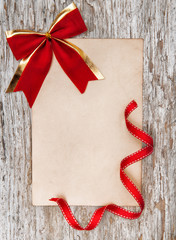 Christmas card with red bow and ribbon