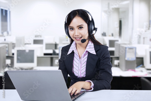 Friendly young woman operator