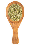 Fennel seeds (Foeniculum vulgare) in the wooden spoon on white b