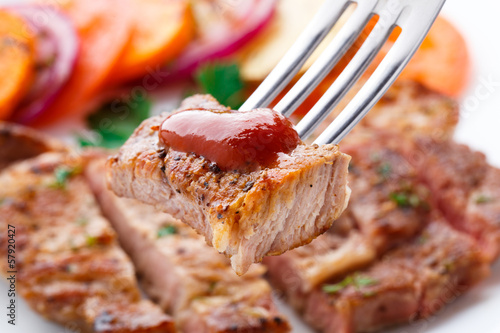 Piece of steak on fork