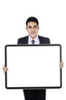 Successful businessman showing empty board