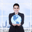 Young businessman holding a globe
