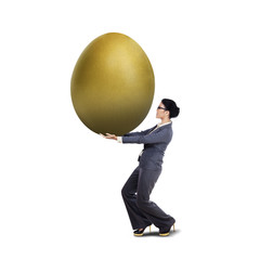 Young businesswoman carry golden egg
