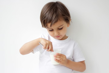 little boy eating yogurt