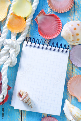 note and sea shell