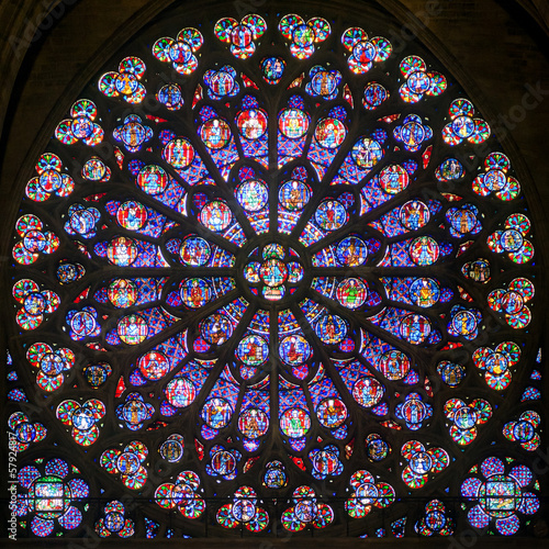 Rose stained glass window in the cathedral of Notre Dame, Paris