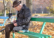 Retired disabled man in an autumn park
