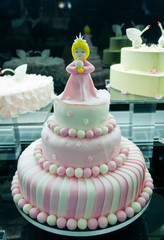 nice birthday layer cake with princess figure on the top