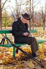 Handicapped elderly man sitting in the park