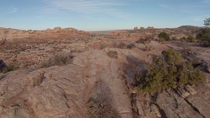 Flying off cliff near Arches National Park switchback road