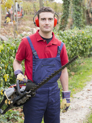 man working bush trimmer