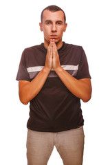 man brunette prays Christianity hands together isolated on white