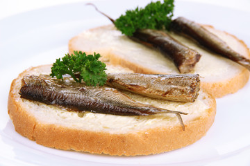 Tasty sandwiches with sardines, close-up