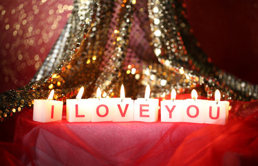 Candles with printed sign I LOVE YOU,on  blur lights background