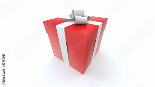 Big red gift box with a white ribbon turning around